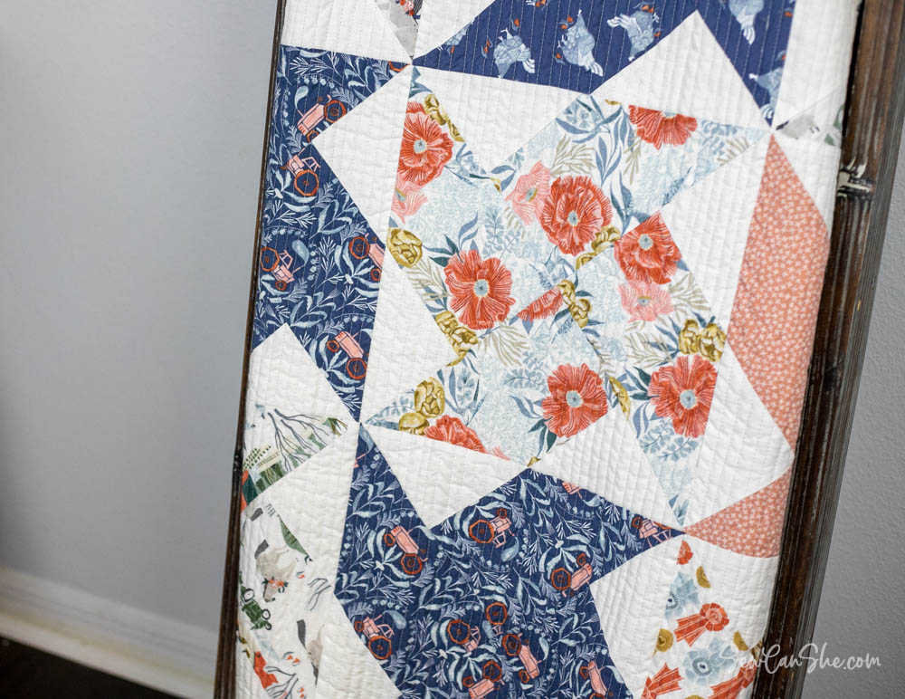 whirlwind quilt on a rack